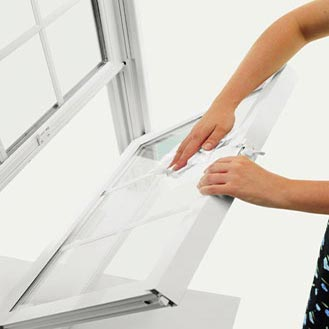 Tilt the sash into the room for easy cleaning without removing screens