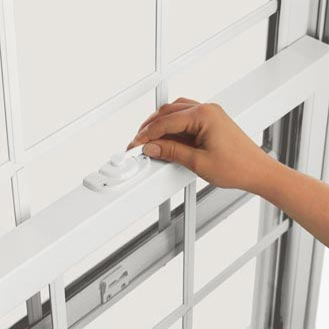 Press the tilt release button and slide the lock lever over the button